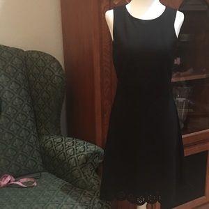Laser-cut, ponte sleeveless a-line jumper dress!